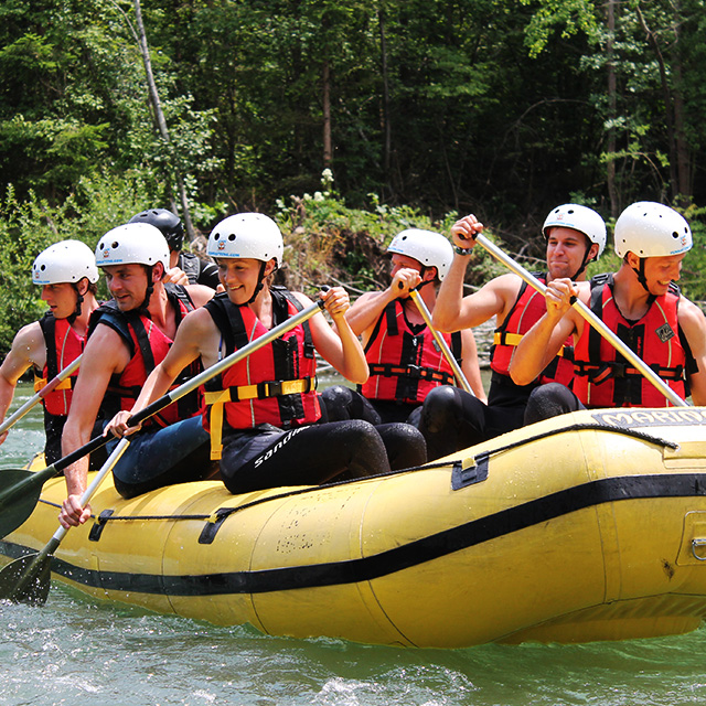 rafting team on a raft ner bled experiencing rafting adventure to the fullest